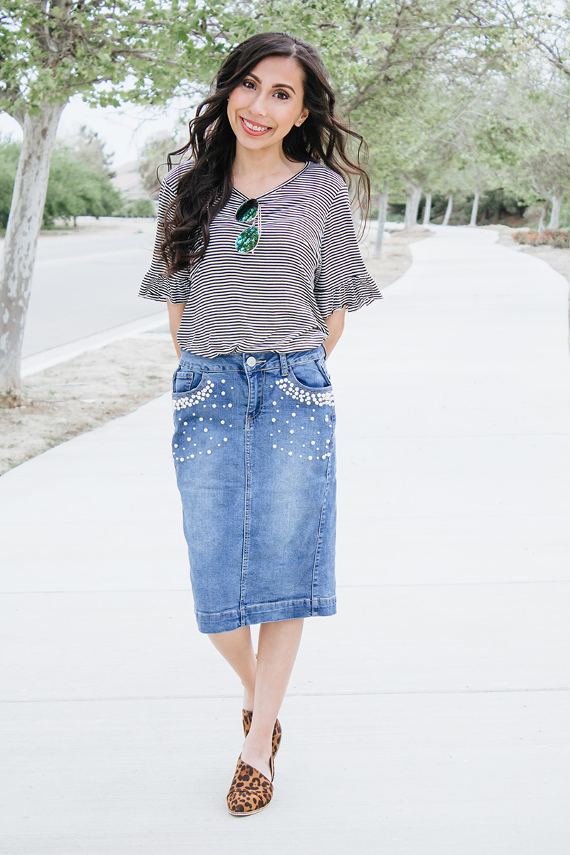 striped top pearl denim skirt leopard cut out booties outfit