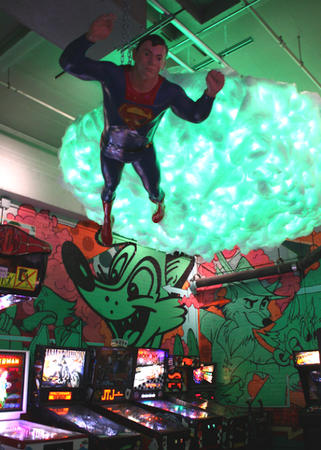 Superman flying high above arcade games at Can Can Wonderland
