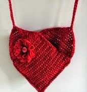 http://translate.google.es/translate?hl=es&sl=en&u=https://cultofcrochet.wordpress.com/2011/06/25/heart-shaped-bag/&prev=search