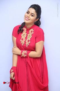 Actress Poorna Latest Stills in Red Dress at Rakshasi First Look Launch  0094.JPG