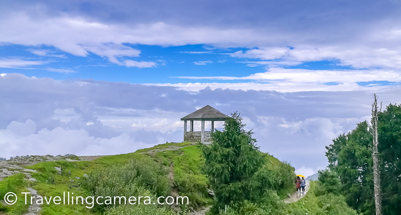 During my recent visit to Dalhousie, we planned to do a small trek to Dainkund (Temple Pohlani). This Photo Journey shares about our experience through clouds and how we beaten the rain. And if you are in Dalhousie during Monsoon, this trek is highly recommended. You literally walks through clouds and it's an easy trek.We drove through Kala Top to the base of this trek, which is entry gate of Air force base. We parked our car there and started the trek. There is well paved path for 1 km, which is maintained by temple authority. This path certainly made our lives easy during monsoons.This is a view after walking up for 250 meters. This road goes down to Dalhousie and Kala Top.As we started the trek, rain started and we thought of skipping it and going to Khajjiar instead. But in few minutes we encouraged each other to use umbrellas and start climbing up. And at the end it proved to be rewarding.Clouds were playing hide and seek with us. At times, they were chasing us and in few minutes sun was shining by clearing them away.Throughout the trek you are exposed to some breathtaking views of valley full of high deodars and birds flying all around. We saw few colorful butterflies on our way but couldn't click them well.We did the trek at our own pace. Stopped many times and enjoyed quick snacks which we were carrying with us. And Urvi was always ready to pose :)On the way, there is a temple which is 2.5 kilometers away from road. Lot of local folks visit this temple. Interesting most of the temples in this region don't have roofs. There is a little shop near the temple from where you can buy snacks and juices.While walking through the mountains, Vibha pointed towards this cloud form. With a smile she says - 'doesn't it look like a giraffe?'. Do you think so?There is a beautiful view through clouds. Most of the times clouds stopped our view of surroundings but such views through clouds were very special.This is 3 kilometers trek which means you need to walk for 6 kilometers. And we had 3 years old trekker with us. Mentioning that to share that anyone can do this trek. It's very easy and the experience can be very rewarding. On a clear day, Khajjiar is visible from top.Panoramic views from top were mesmerizing.There is small shelter on the way. We took a break here where it started raining heavily.Every now and then we were stopping to views awesome scenes all around us. Here Urvi is trying to locate Khajjiar :)Not sure what Indu is trying to do on phone because there is no signal on these hills :) . Probably checking the photograph she just clicked with her phone.We reached there quite early and met this gentleman. He offers horse riding to tourists coming to this place.Urvi loved walking throughout and showing some interesting views to us. Vibha and Urvi were most observant from the lot.It was time to head back and don't miss to watch time-lapse videos shared below.