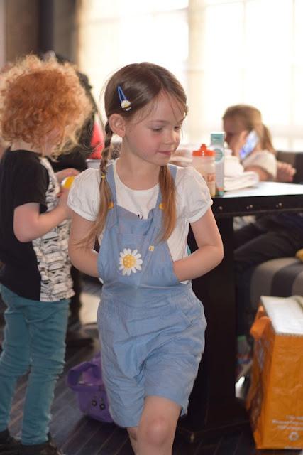 Elizabeth wearing Frugi Daymer Bay Daisy Short Dungarees
