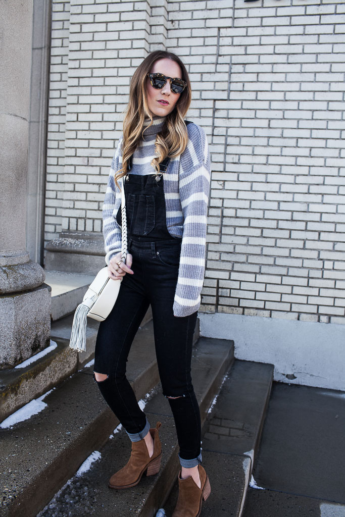 Pair a turtleneck with overalls for a cozy winter look.