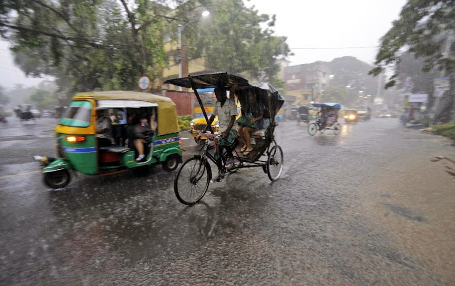 A rickshaw driver transports a passenger in the rain in Kolkata, India, Wednesday, July 2, 2014. Normal traffic was affected in several areas of the city because of overnight rainfall that caused water-logging, according to news reports.