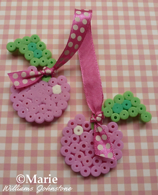 Full photo instructions on how to make cherry perler bead with ribbon embellishments craft crafting pegboard