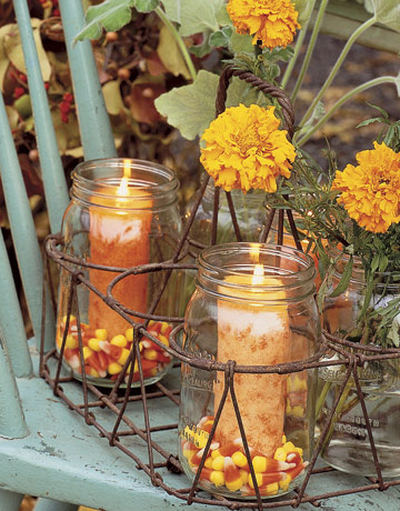 These mason jar candle holders filled with candy corn are festive for fall.