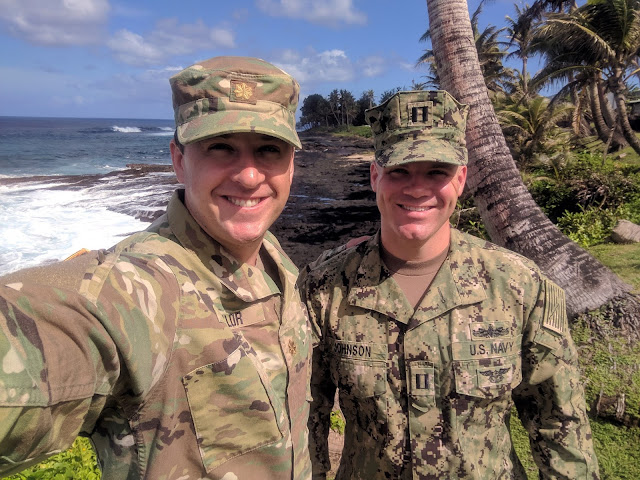 Two military men in uniform take a selfie at the beach. USU's first two GSN students to complete a clinical placement in American Samoa, Maj. Douglas Taylor, left, and Lt. Christopher Johnson. (courtesy photo)