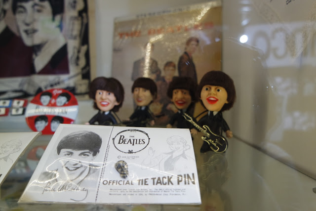 tiny, thumb sized The Beatles dolls