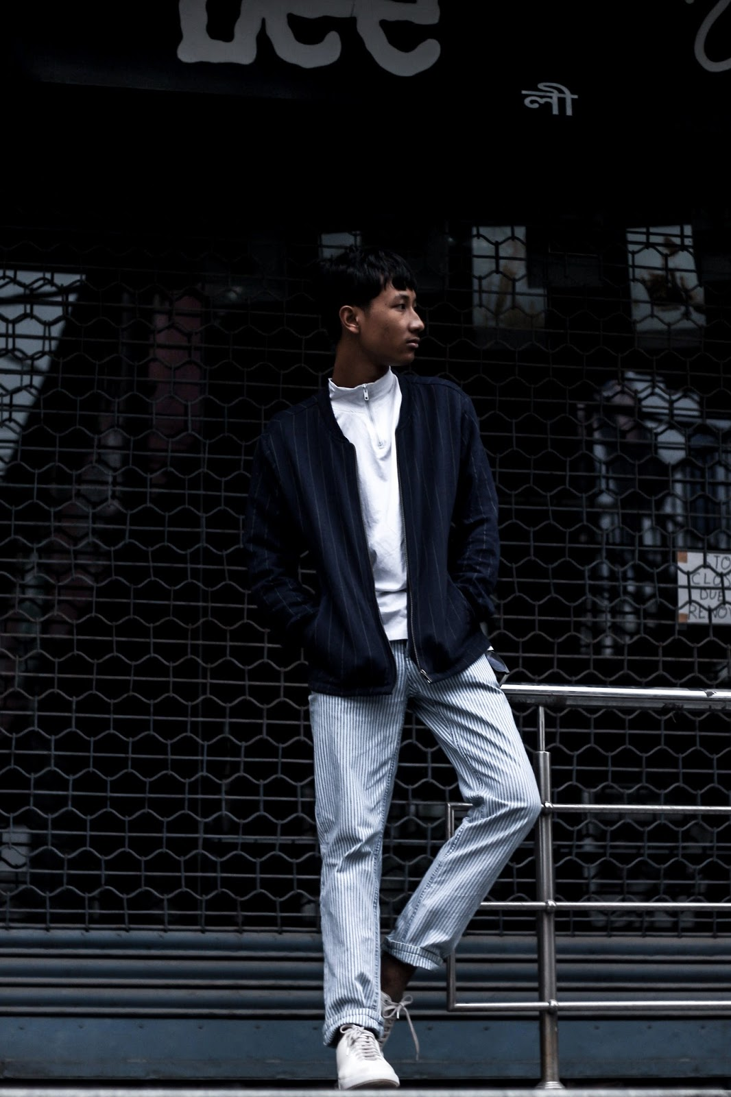 TheQuirkyminimal by Kangkan Rabha Menswear style & lifestyle blog How to wear Stripes on stripes Wearing- Koovs tee & Jacket, Thrifted Jeans & BEONZA White Sneakers