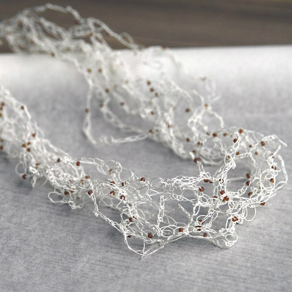 Crocheted Fine Paper Yarn Necklace is white with tiny glass seed beads