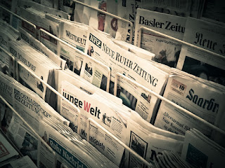 A picture of many newspapers.