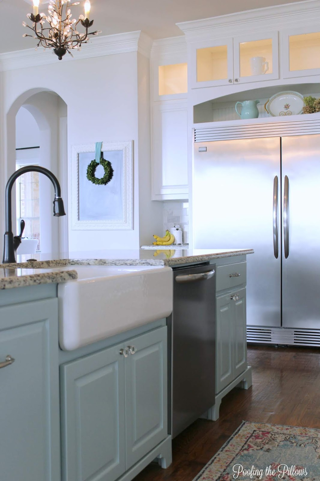 light and bright kitchen with Sherwin Williams Watery on the island.