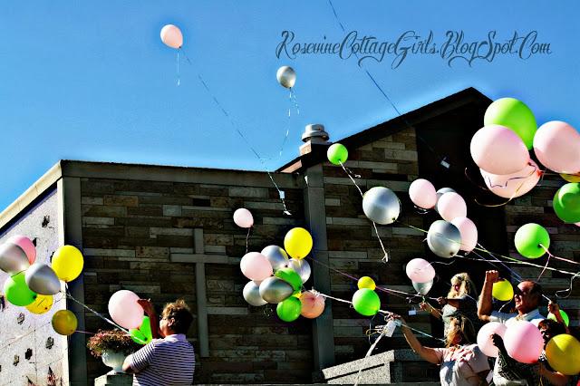 people releasing balloons at the cemetery | infant loss | Trisomy 13 | rosevinecottagegirls.com