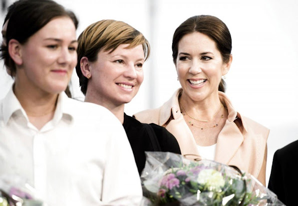Crown Princess Mary of Denmark visited the collection stand of fashion designing students