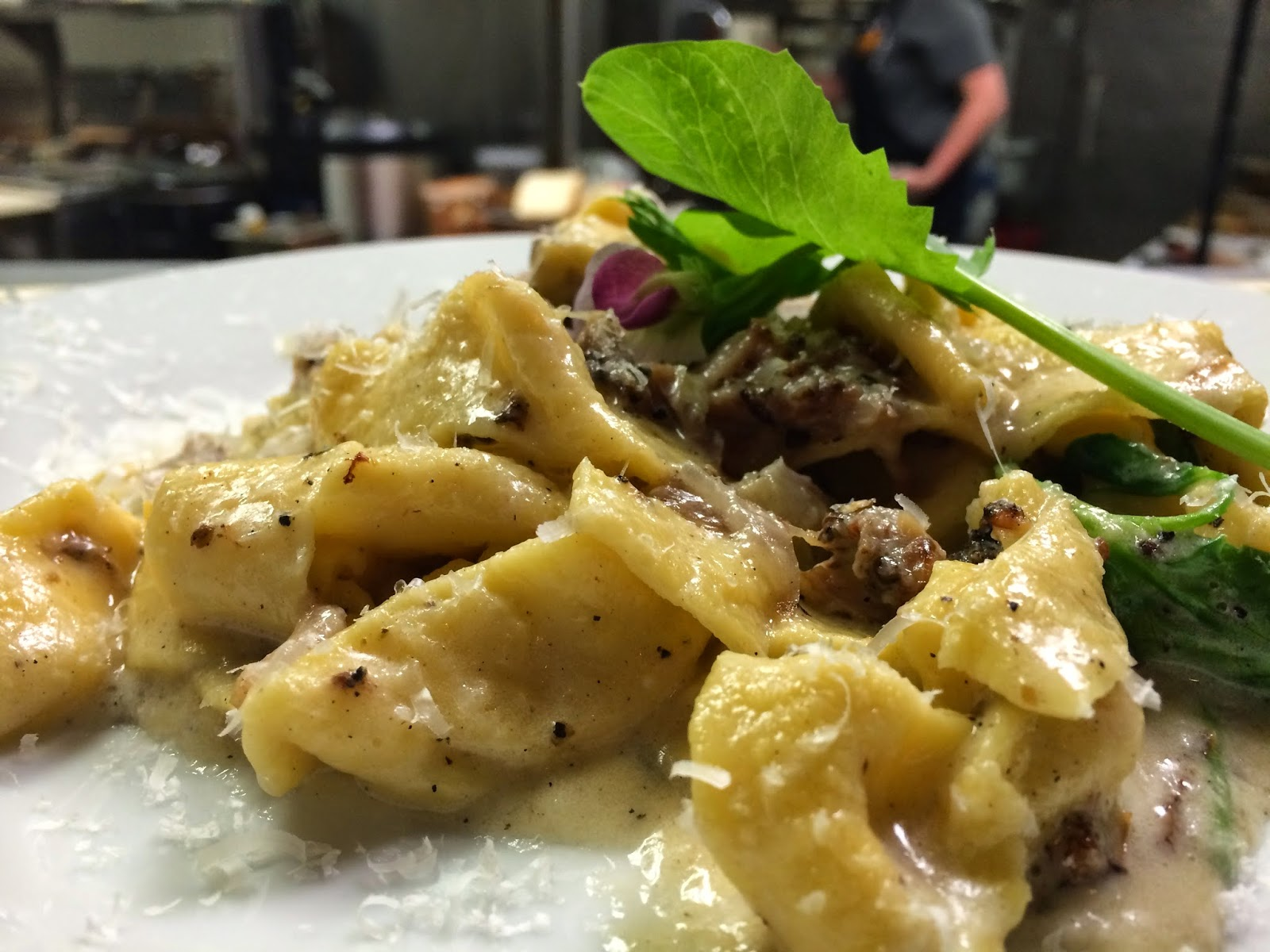 House-Made Pasta* Carbonara: Pork Cheek, Black Pepper Butter, Pea Shoots, Goat's Milk Cheddar, and Toasted Breadcrumbs. *Pasta Noodles made Fresh to order.