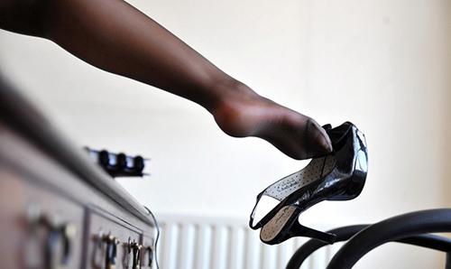 Mumbai escort showing off her leg in black stocking