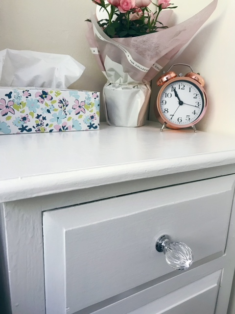 Beside drawers with glass knobs