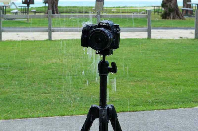 Pentax on tripod taking shower at beach