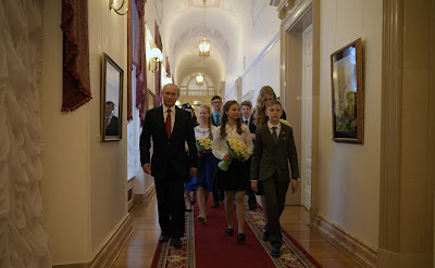 Following the presentation of passports, Russian President gave young citizens a tour to his office.