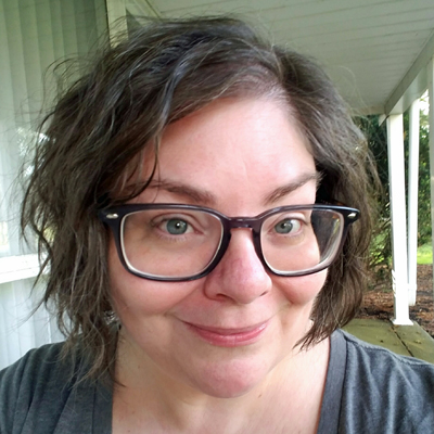 image of me sitting on my porch with wavy hair