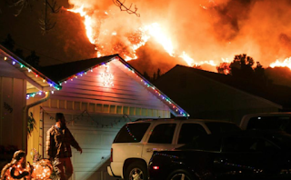California governor blames devastating wildfires on climate change and says deadly winter infernos will be 'the new normal'