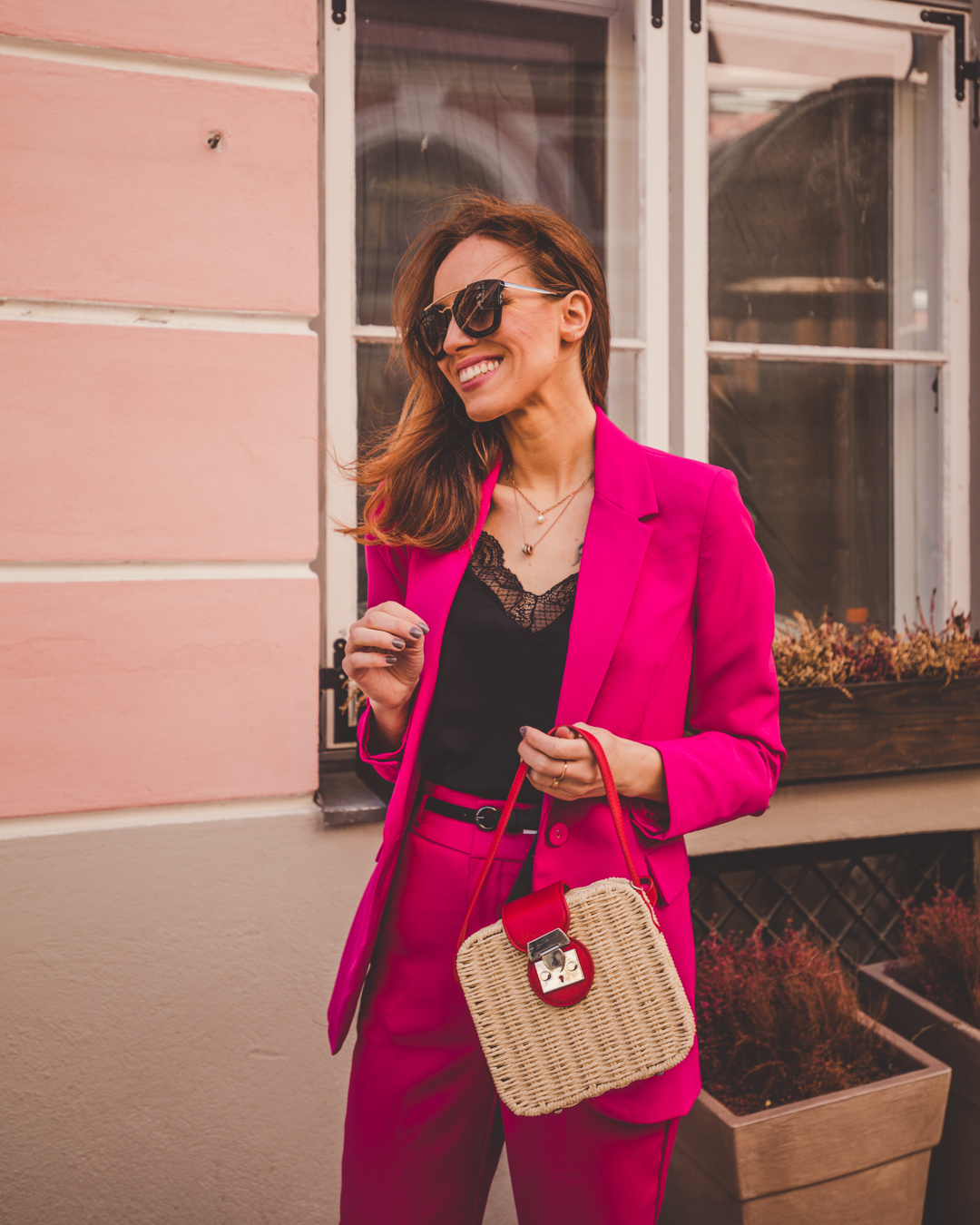 pink matching suit straw bag outfit