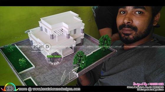 Designer holding a 3D Printed house in his hand