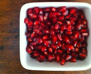 One half of pomegranate de-seeded