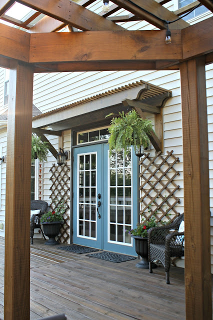 Wood trellis over door