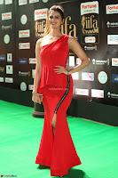 Meenakshi Dixit in Red One Shoulder Red Zipped up gown at IIFA Utsavam Award 84.JPG