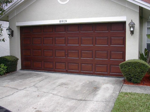 I Completed Another Garage Door Painting Project This Month In Tampa. I  Painted This Metal Garage Door And Metal Front Door To Look Like Wood.
