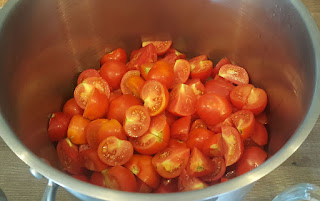 One of several batches of tomatoes to be processed
