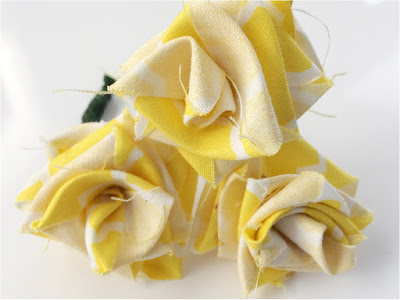 Can't find the flowers you need in your party colors? Make your own fabric flowers in a few easy steps out of scrap fabric you already have at home.  These fabric roses are great as Beauty and the Beast roses, Bachlorette party roses, or as the yellow rose of Texas for your Cowgirl party.  The possibilities are endless!