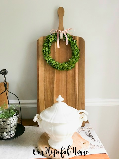farmhouse dining room ironstone balance scale cutting boards boxwood wreaths