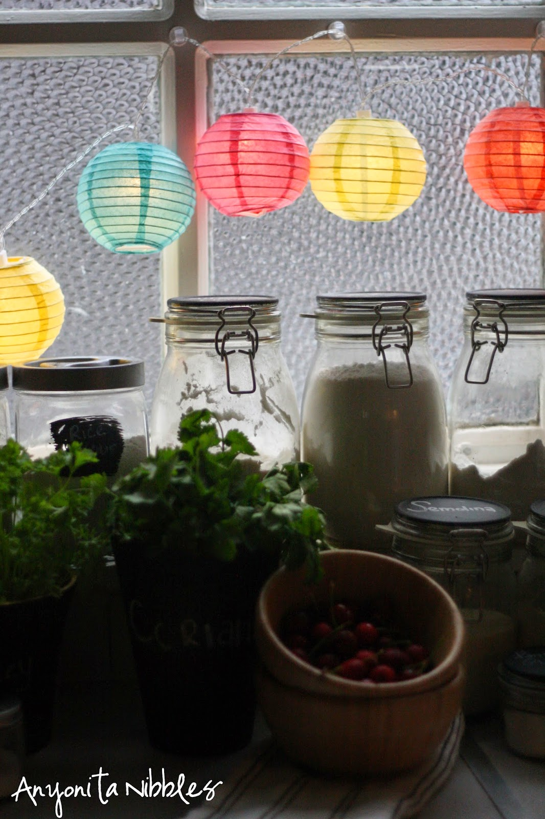 Paper lanterns add pop of color to a basic kitchen from Anyonita Nibbles