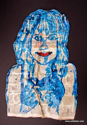 portrait on crumbled old newspaper