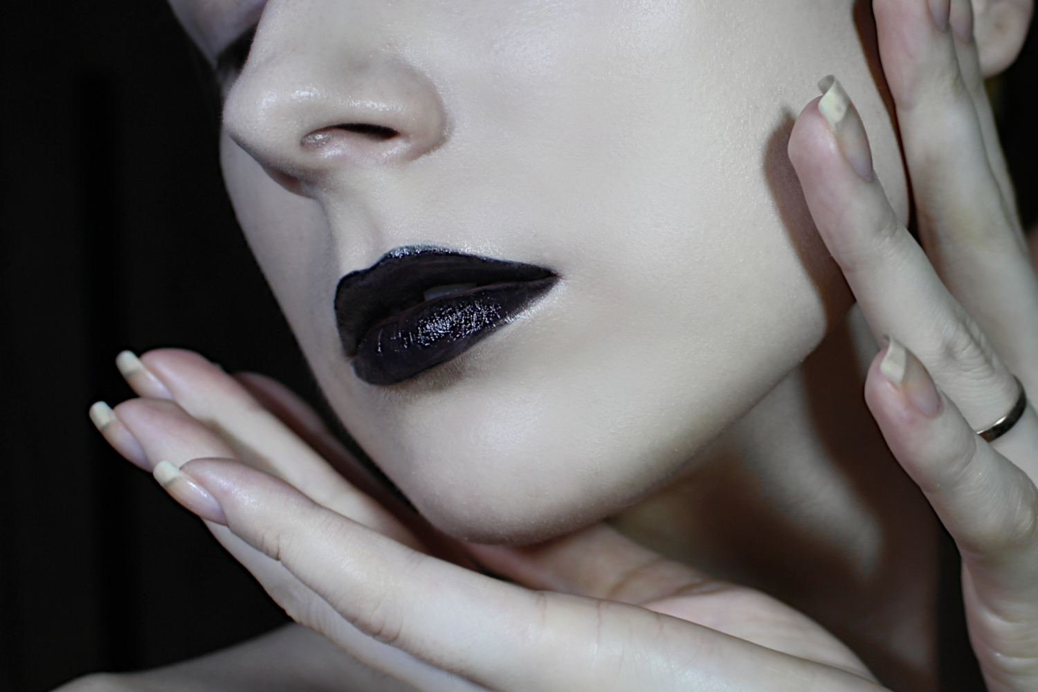 girl is wearing black lipstick