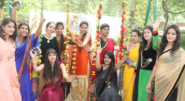 Girls of Khajani Woman's Vocational Institute raised pings on the swing at Teesa Mela, Singing Mangal Song