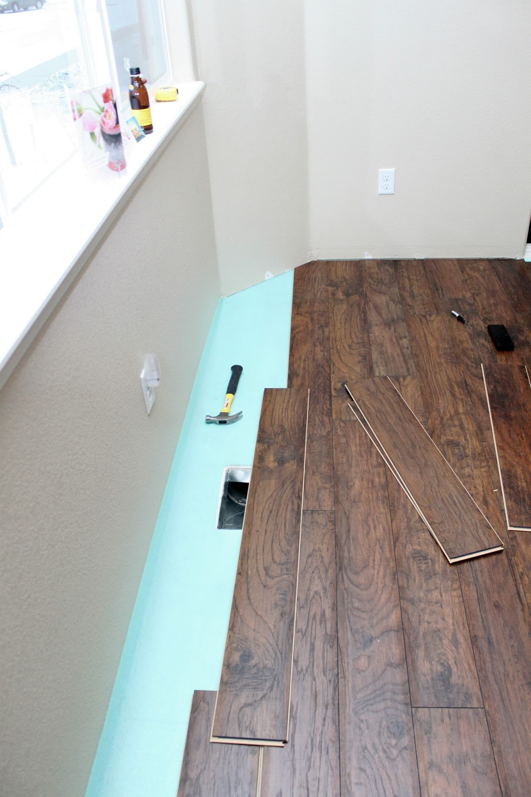 Our modern homestead diy laminate wood flooring project - Laminate or wood flooring ...