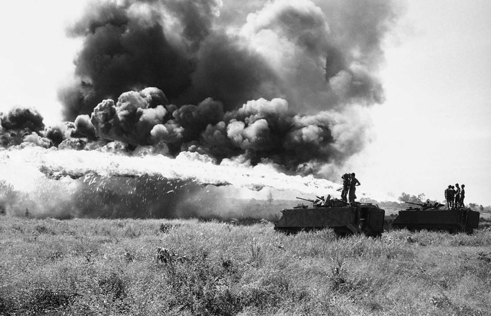 South Vietnamese troopers test fire flame throwers mounted atop APCs prior to moving out on operation west of Krek, Cambodia, on November 28, 1971.