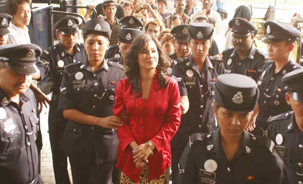 Umie Aida plays the convicted shaman, Diana Dahlan in DUKUN (2018)