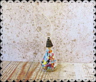 image diy miniature christmas bauble ornament tutorial beaded thread cord or twine through bead cap and hang beaded bottle as ornament