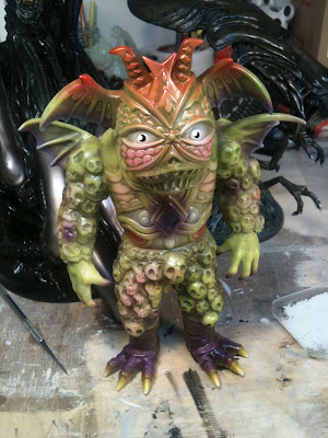 San Diego Comic-Con 2011 Exclusive Glow in the Dark Ultrus Bog Vinyl Figure by Skinner.jpg