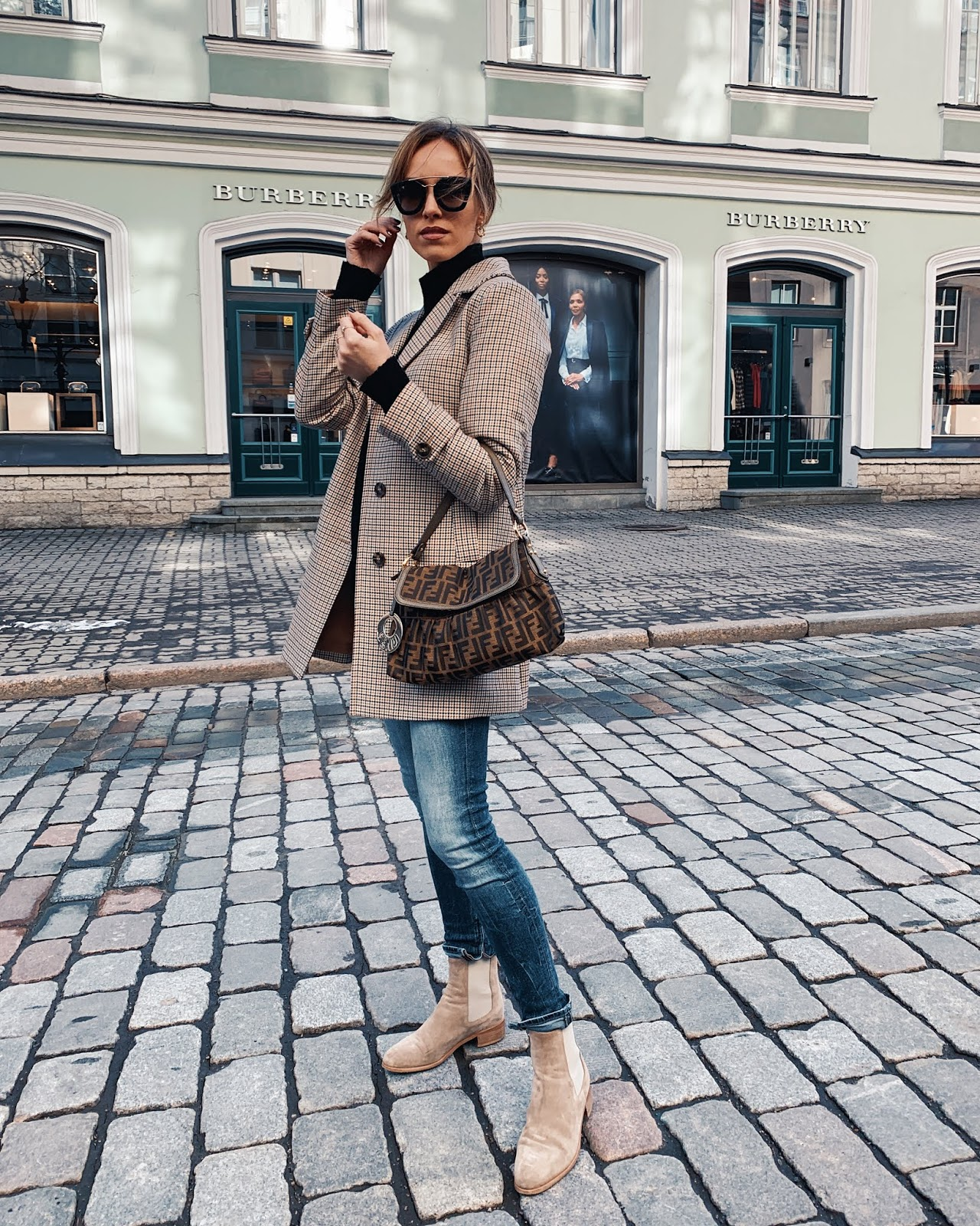 checked coat blue jeans fendi bag suede chelsea boots spring outfit