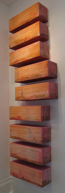 Abstract art painted on boxes by Louisiana artist George Marks