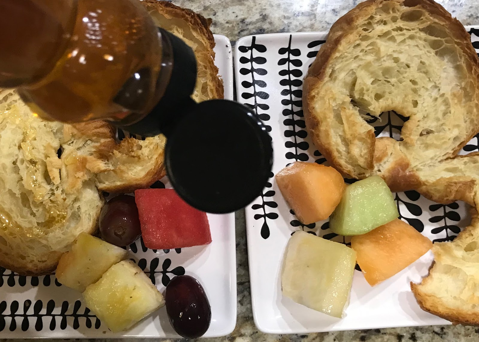 Image: Honey being poured over bread, side of fruit. Bits Of Food