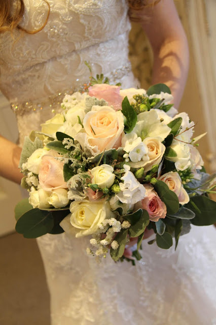 channel s winter wedding bouquet included a fabulous collection of fresh roses freesia phlox hellebores and silvery grey frosty foliages