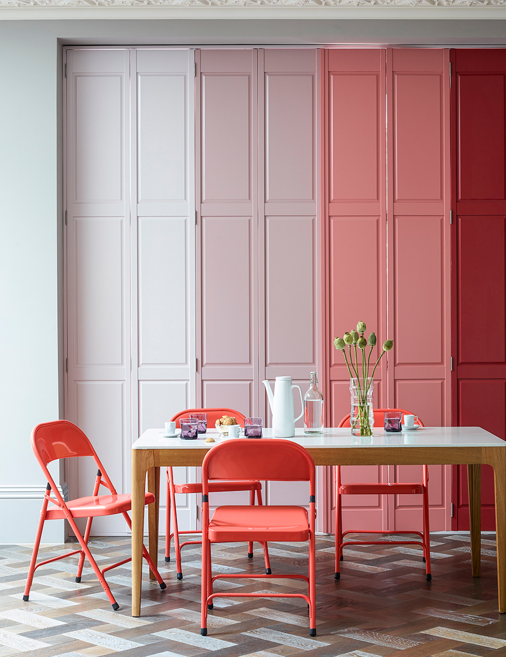 Shutterly Fabulous - French For Pineapple Blog - ombre pink solid door shutters in modern dining room setting with coral chairs and parquet floor