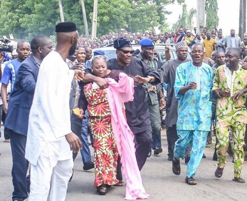 Pandemonium At Senator Adeleke's Burial As Woman Rescued From lynching By Angry Mob ...See Photos