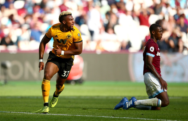 Adama Traoré of Wolverhampton Wanderers celebrates after scoring his team's first goal during the Premier League match between West Ham United and Wolverhampton Wanderers at London Stadium on September 1, 2018 in London, United Kingdom